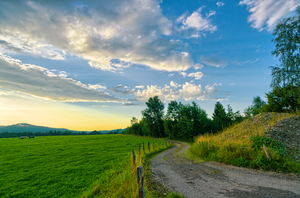 Farmland Sunset: Summer Sunset above hilly Farmland, Country Road, Bavarian Alps