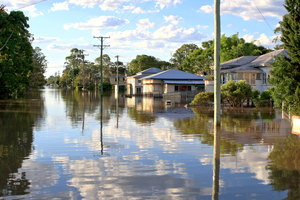 Queensland Floods 2013: A flooded street in a regional town on a bright, calm day during the 2013 Queensland floods. Taken January 27. (The date on my camera hasn't been set correctly, hence an incorrect date on the EXIF information.)