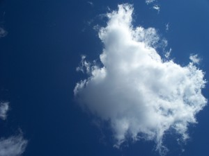 Fluffy White Cloud: A fluffy white cloud in a deep blue sky