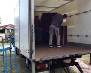moving out5: team of volunteer helpers removing bookshelves