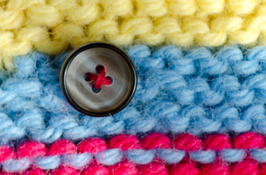 Button: Button on wool background