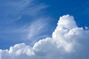 Spring clouds: White clouds on spring blue sky background