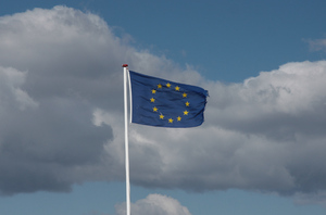 Europe: European Flag in the storm with ragged edge. Perhaps a symbol for Europe today and its challenges.