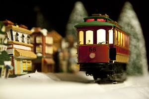 Christmas Train: Shallow focus of a train car with a village scene in the background.