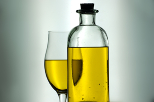 Olive oil  1: Bottle and cup full of virgin olive oil