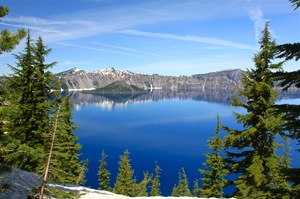 Crater lake view: view of crater lake, still weather with snow tops