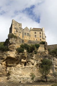 Clifftop castle: A castle on a clifftop by the river Dordogne, France.