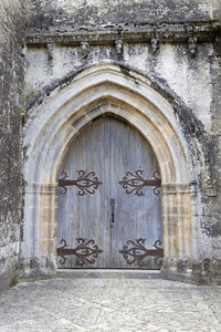 Church door: Door to a church in the grounds of a castle in the Dordogne, France.