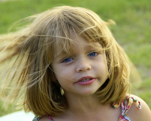 Child in the wind: young child with hair  blowing in the wind
