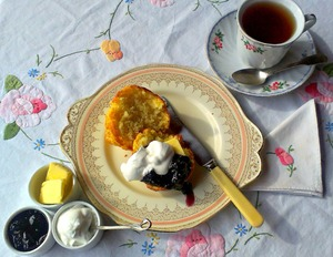 Tea and scones: Setting of tea and scones with butter, jam and cream