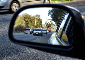 along the road1: mirror image of road traffic