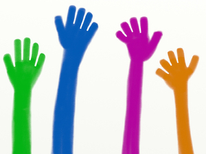 Helping Hands: Colourful hands raised in the air.