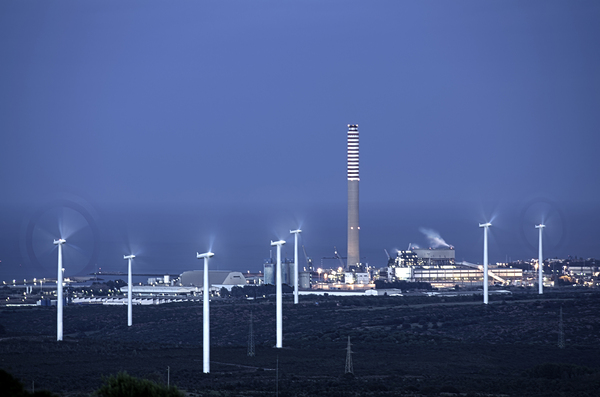 Wind and Energy : Wind turbine with power plant and industries. Night photography with long exposure.