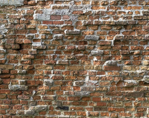 Old brick wall: Wall of an old coastal cottage in England.