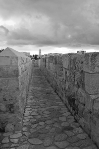 Ancient wall, Jerusalem B/W: A pathway along the top of the perimeter wall of old Jerusalem, Israel. Photography at this site was freely permitted.