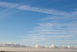 Summer sky: vapour trails from aeroplanes in the summer sky.