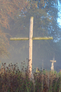 Wooden cross in garden