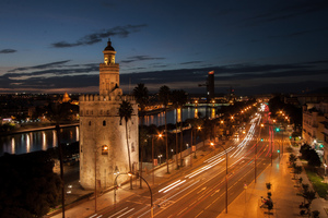 Gold Tower, Seville, Spain: View from an adjacent penthouse, here you can see the tower, the Paseo de Colón Avenue, the Guadalquivir river and the Pelli Tower near the horizon.