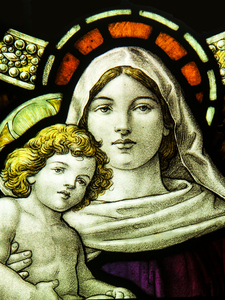 Madonna and Child: Victorian stained glass window in a small country church.
