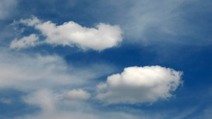 They're coming...: Clouds chasing one another on a midday sky. Yes, they are Polish clouds. Shot in the very city center of Poznan :)).No restrictions. Still, I would love it if you left a note on how you're using the image. Thanks!