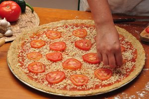 Pizza making 6: Shots of the pizza making process, step by step - Adding tomato