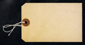 Paper Tag: A vintage paper tag on black.