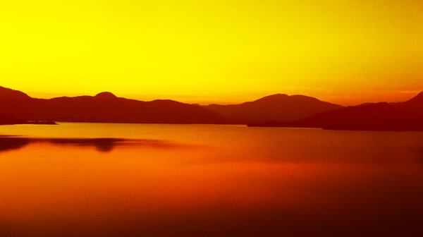 Sunset 1: Sunset against the Backwaters of Chilika Lake in India