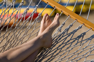 Hammock time: Closeup of a womens feet relaxing in a Hammock
