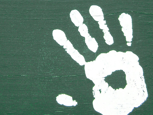 Painted Hand: This is a wall painting done by some kids. Somebody decided to add a little personal touch to the artwork! :-)