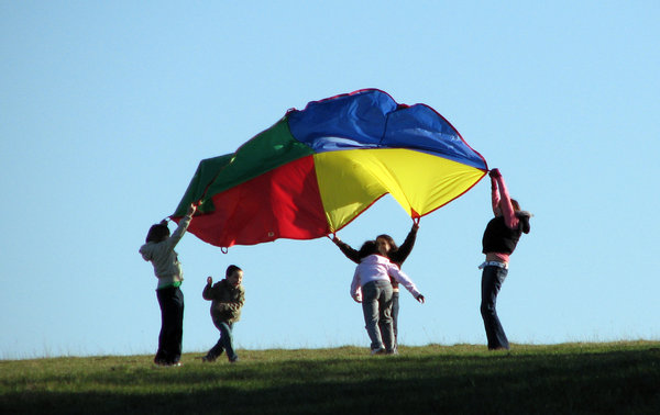 Playing in the wind: Kids playing in the wind