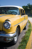 Yellow Cuban classic car 2: Leftside of a Cuban classic car