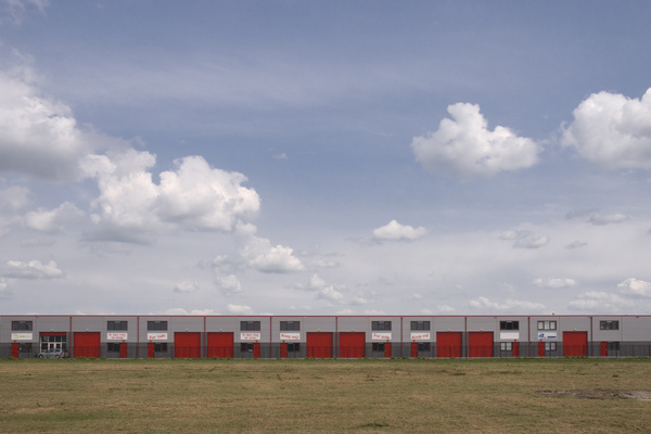 Regularity in industrial area: Nice clouds and red doors