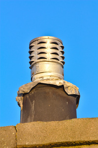 Chimney: Chimney/flue against a clear blue sky