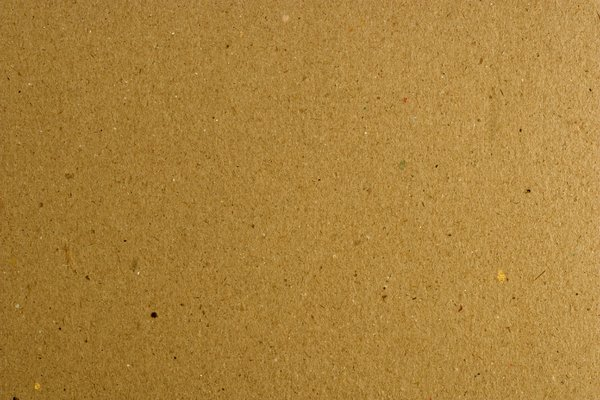 Thin Cardboard Texture: A detailed shot of some brown cardboard. For use a a fill layer or a texture.