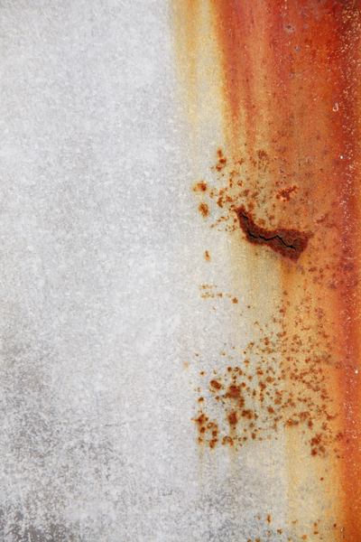 Rusty Metal Sheet: A sheet of metal with a vertical rust stain on the right hand side.