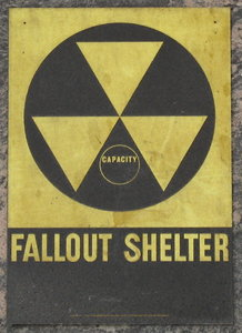 fallout shelter: a fallout shelter sign.