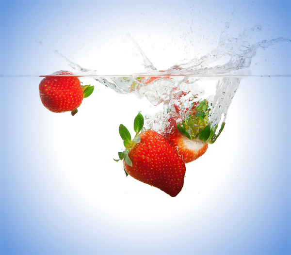 Strawberries fall under water: Picture was made in a studio in Rotterdam
