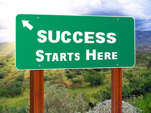 Success Starts Here Sign: Freeway styled sign. PSD available.