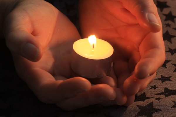 Here's a light: Offering  light and heartiness in figure of a candle