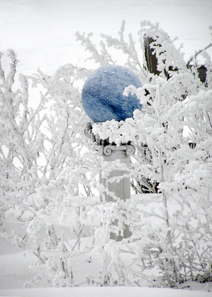 Blue Gazingball in the Snow: A blue gazing ball in the snow.