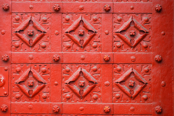 Red metal flowers texture: Pattern wit red squares from old doors