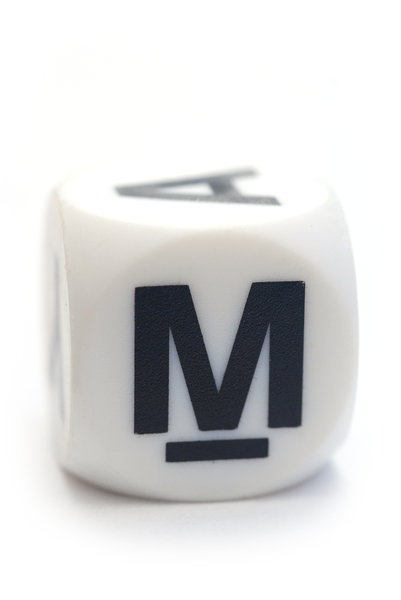 Letter M on the dice: Character on the cube
