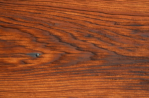 Sun worn wood: Close up of a warm wood grain texture.