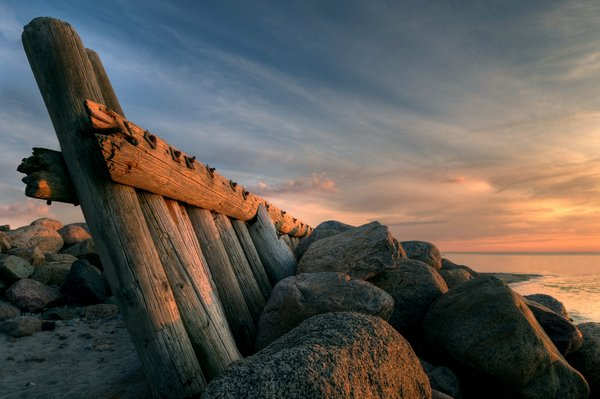 Breakwater - HDR: Breakwater and coastbarrier in evening light (sunset). The image is HDR.