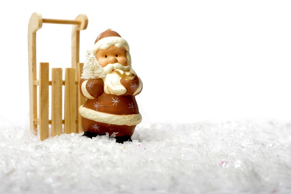 Santa and sledge in snow: Santa Claus with a wooden sledge in snow
