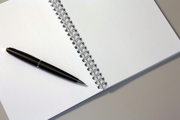 Note and pen: Note book with pen over it