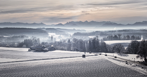 Morning on Winter Landscape: Snowy Landscape with small Village at early Morning, foggy Atmosphere