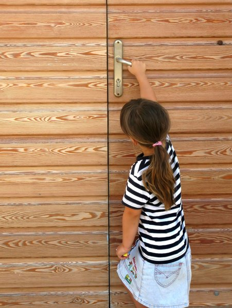 small girl,big door: none