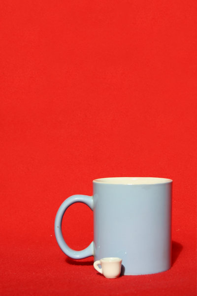 Mugs: Two mugs on the red background