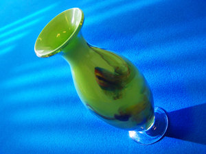 vase: green vase on pool table surface